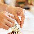 Royalty-Free Stock Photo: Chef hands garnishing tasty dish with grated cheese