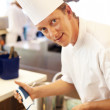 Royalty-Free Stock Photo: Chef working in kitchen