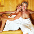 Middle aged couple enjoying a hot sauna at the spa resort - Foto Stock