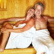 Middle aged couple enjoying a hot sauna at the spa resort - Stock Photo