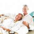 Royalty-Free Stock Photo: Mature couple lying on bed