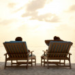 Royalty-Free Stock Photo: Couple relaxing at seashore in beach chairs