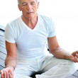 Fit mature man practicing yoga - Stock Photo