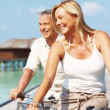 Royalty-Free Stock Photo: Happy mature on bikes outdoor smiling
