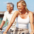 Royalty-Free Stock Photo: Mature couple on holiday enjoying cycling