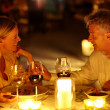 Mature couple having a romantic candle light dinner - Stok fotoraf