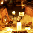 Couple enjoying a romantic candlelight dinner - Foto de Stock
