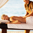 Woman receiving massage at spa resort - Zdjęcie stockowe