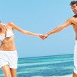Sunny honeymooners - Stock Photo
