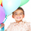 Little cute girl with multicolored air balloons - Stock Photo