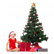 Royalty-Free Stock Photo: Surprised little girl with Christmas tree and gifts