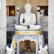 Shrine with white stone Buddha - Stock Photo