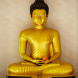 Golden Buddha in meditation mudra - Stock Photo