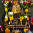 Sacred shrine, showered with offerings - Stock Photo