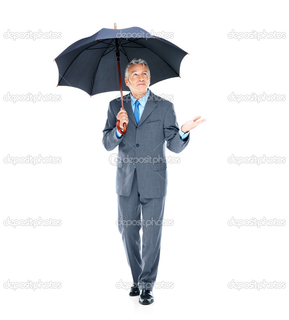 Senior businessman reaching to see if the rain has gone on white background — Stock Photo #12151209