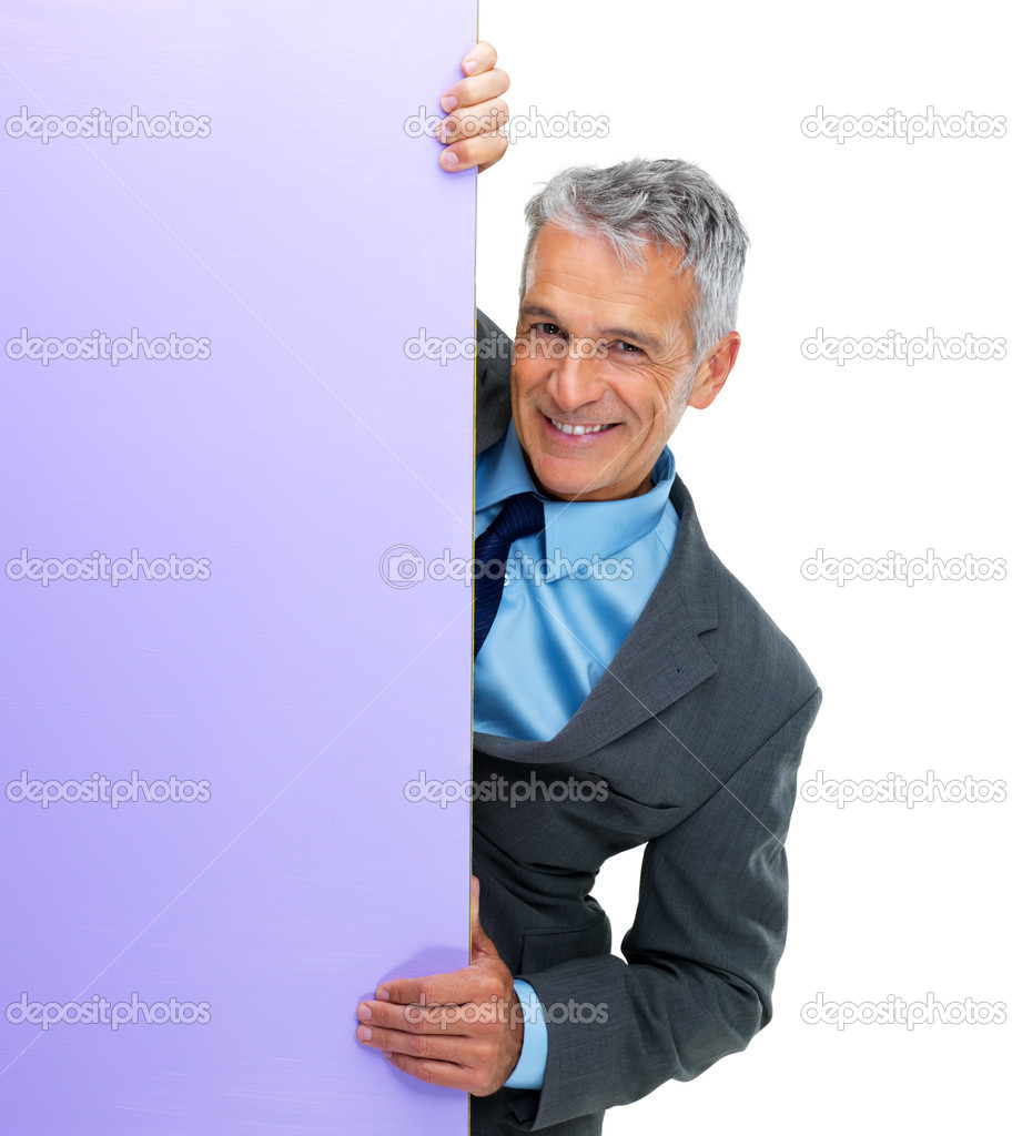 Portrait of smiling business man holding a  color blank board against white background — Stock Photo #12151388