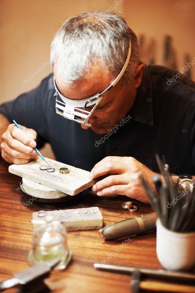 Jeweler hard at work making at rings  Stock Photo #12151542