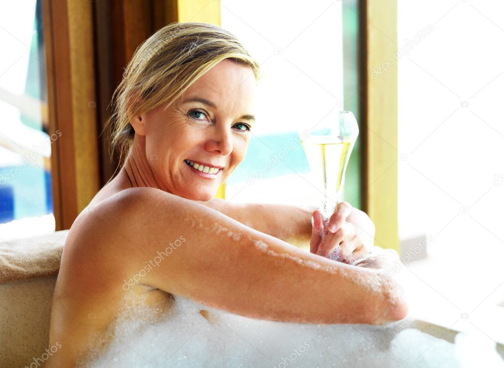 depositphotos 12152528 Happy mature woman relaxing in bubble bath with a glass of cocktail Gotta love hotel room sex ... yummmmm