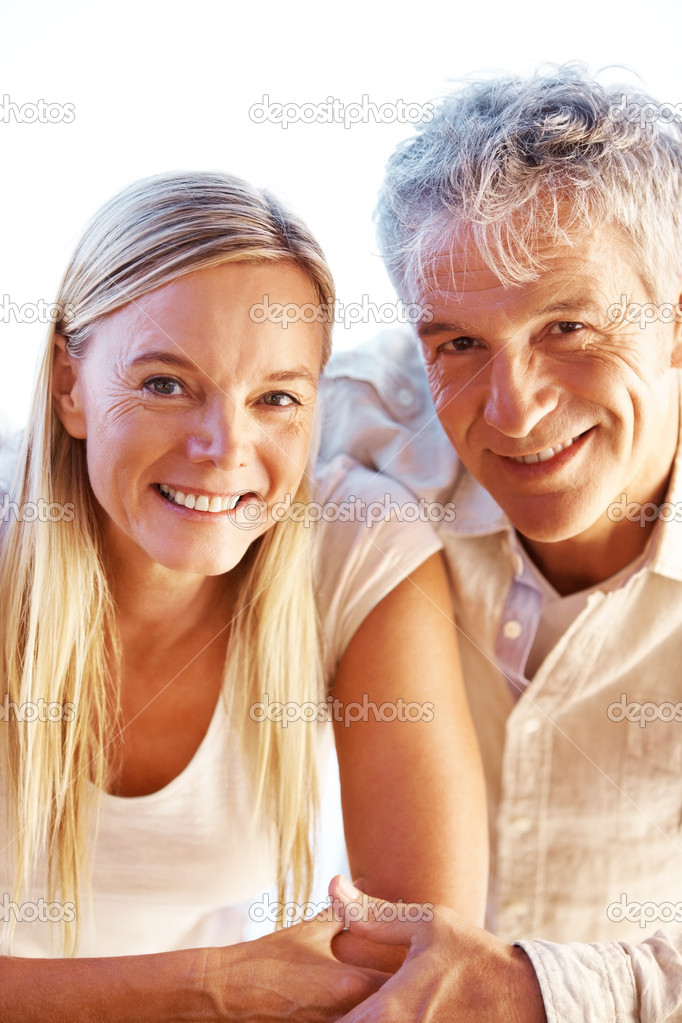 Closeup portrait of beautiful mature couple together — Stock Photo #12153489