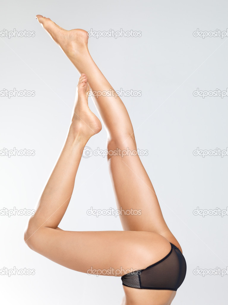 Long legs of a young woman raised in the air as if she is doing a handstand — Stock Photo #12154710