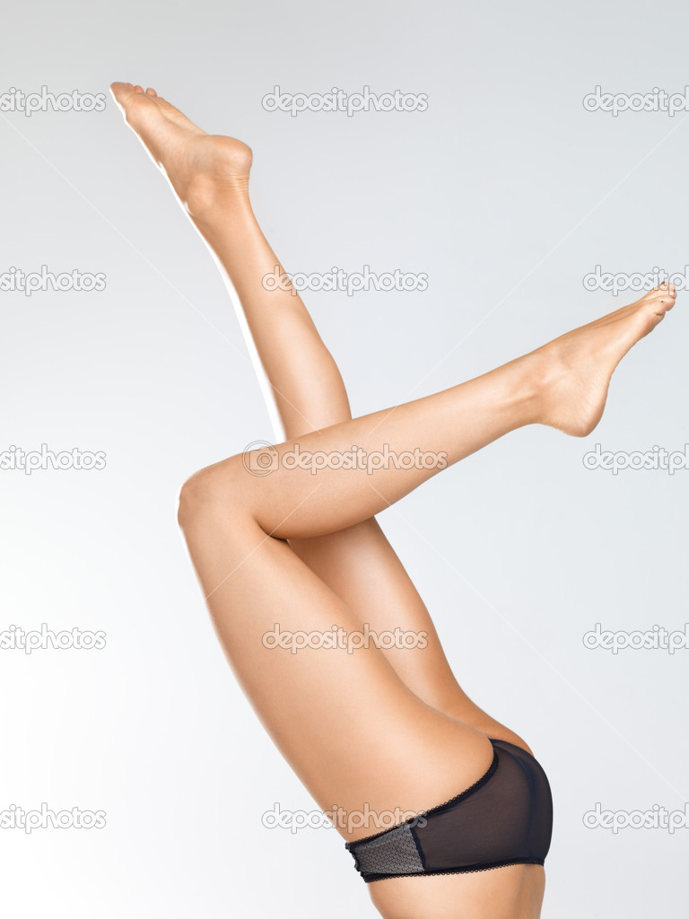 Isolated females beautiful slender legs raised in the air as if she is doing a handstand — Stock Photo #12154713