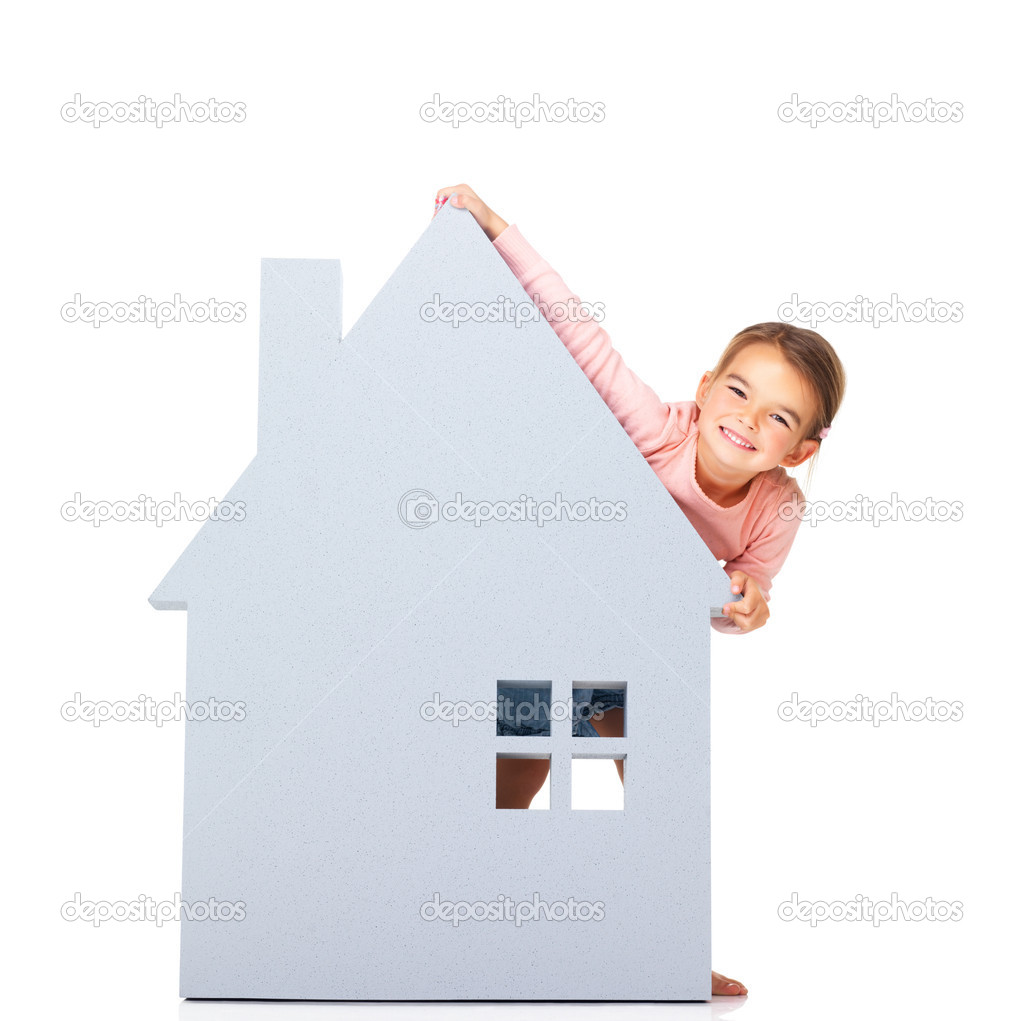 Portrait of sweet young child with a big house icon on white background  Stock Photo #12154872