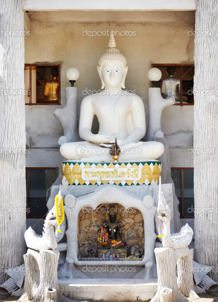 Pale stone carved Buddhist shrine with miniature figurines and place for offerings — Stock Photo #12155562