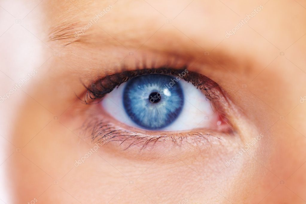 Macro image of a stunning female eye looking at you with a striking blue iris — Stock Photo #12155661