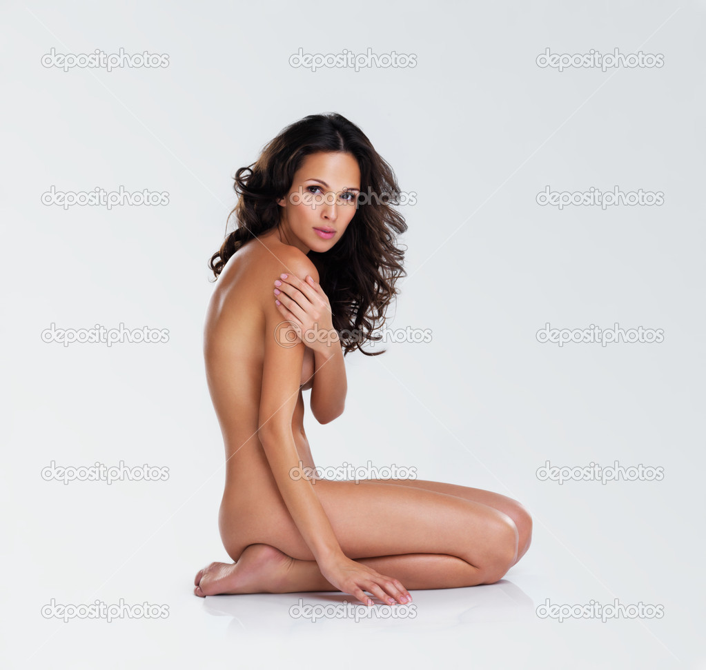 Portrait of a sensual nude young woman kneeling while isolated on white — Stock Photo #12155759