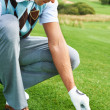 Teeing up for 18 holes - Stock Photo