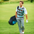 Happy to be his own caddy - Stock Photo