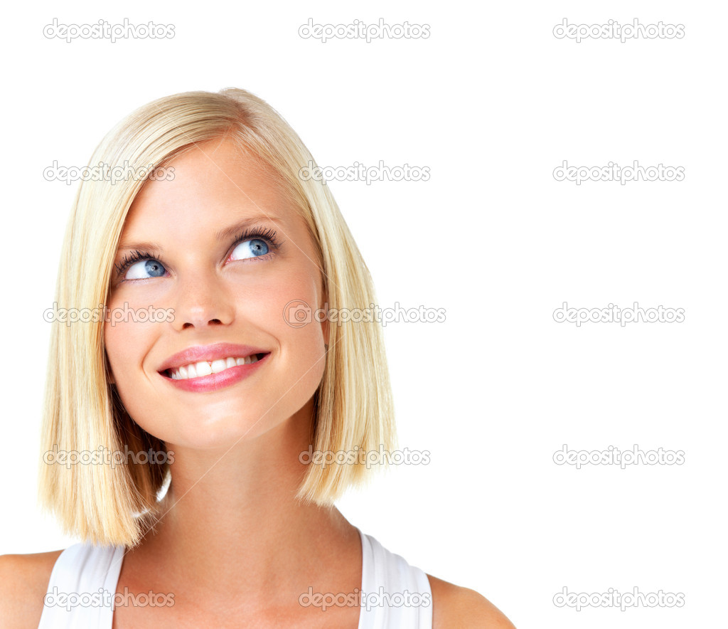 Beautiful blonde woman looking up at copyspace with a smile  Stock Photo #12235985
