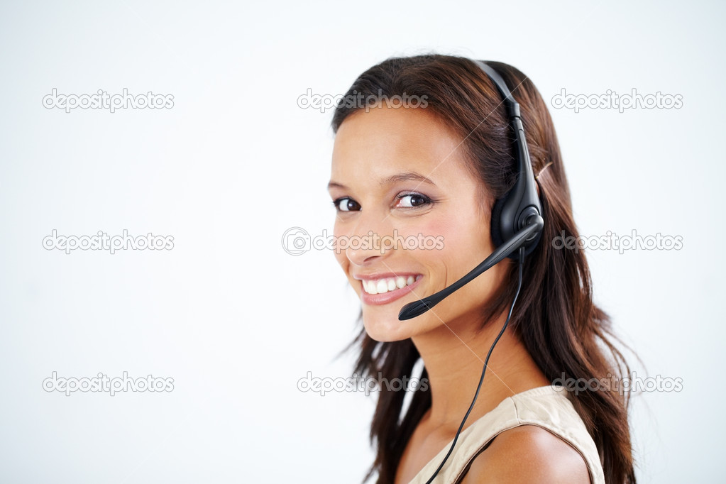 Beautiful young customer assistant wearing a headset - copyspace — Stock Photo #12237928