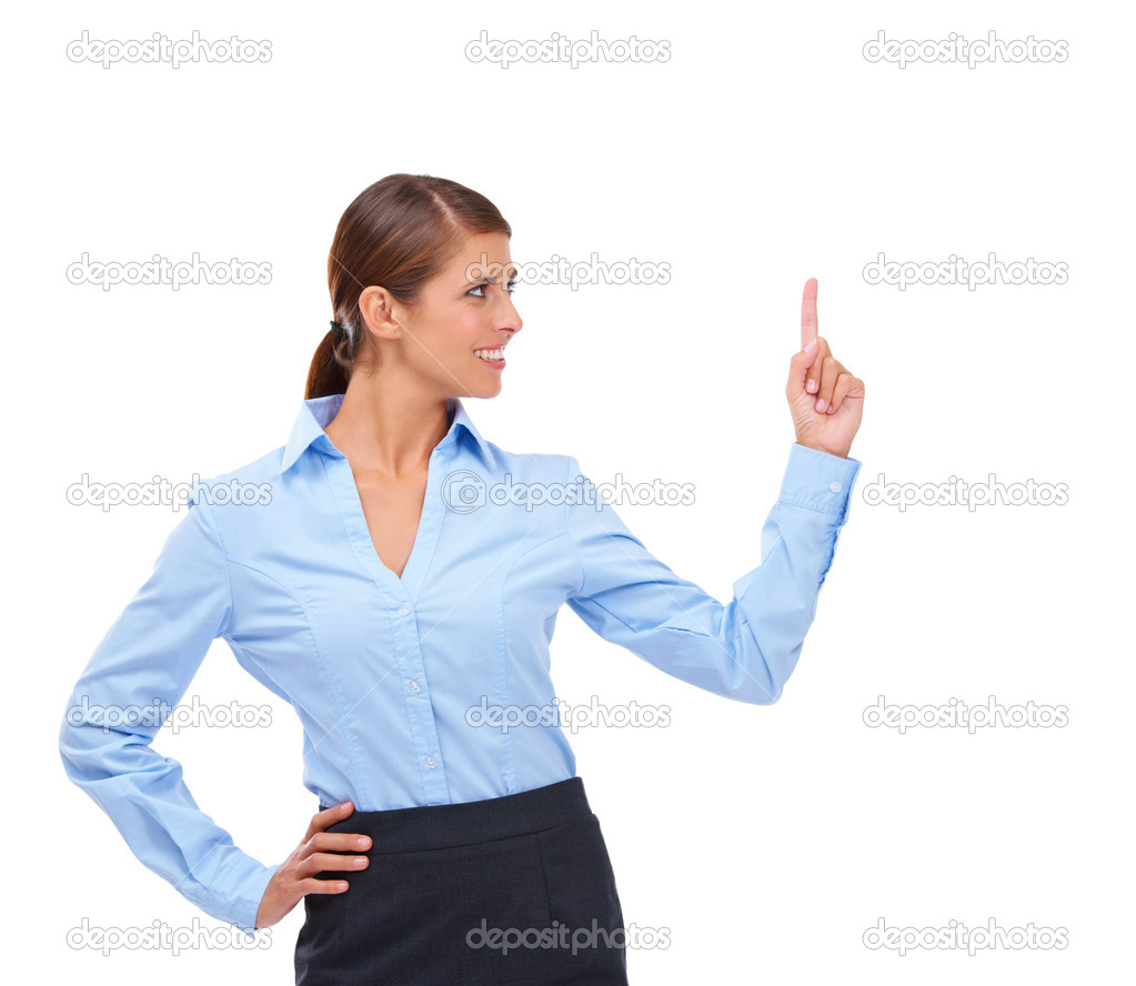 A pretty young woman pointing upwards towards the copyspace — Stock Photo #12238283