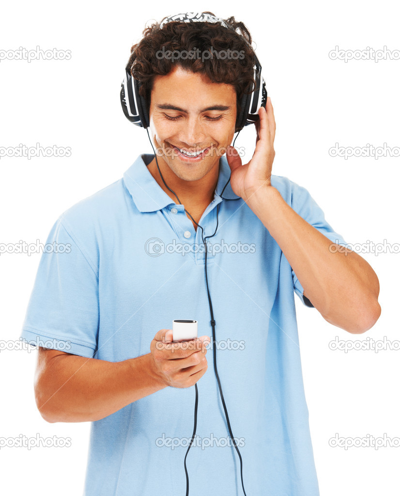 A young man listening to his mp3 player  Stock Photo #12239526