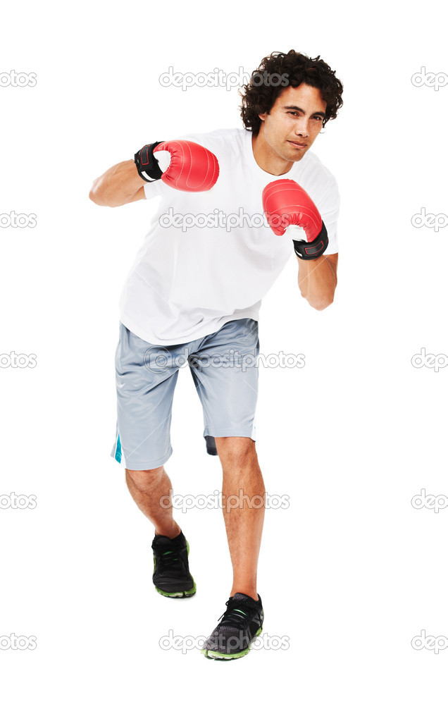 Portrait of a young boxer standing with his fists up — Stock Photo #12239622