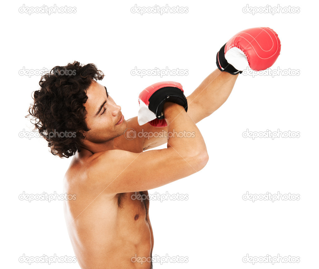 Profile of a young boxer punching the air — Stock Photo #12239626