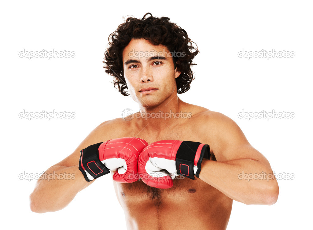 Portrait of a young boxer wearing gloves — Stock Photo #12239628