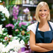 Confident in her skills as a florist - Stock Photo