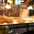Fried insects at a streetmarket in Thailand - Stock Photo