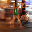 Two Thai women walking with their take-aways - Stock Photo