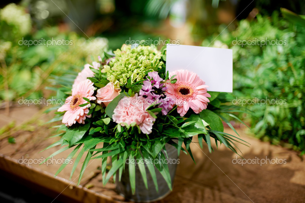 Closeup of a pretty potted flower arrangement and a card  Stock Photo #12240053