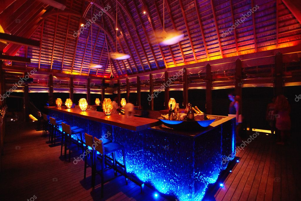View of a brightly lit bar area in a resort in the Maldives — Stock Photo #12240720