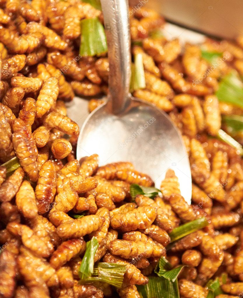 Fried larvae at a street market in Thailand — Stock Photo #12241177