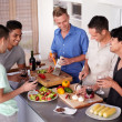 Enjoying good food and great friends - Stock Photo