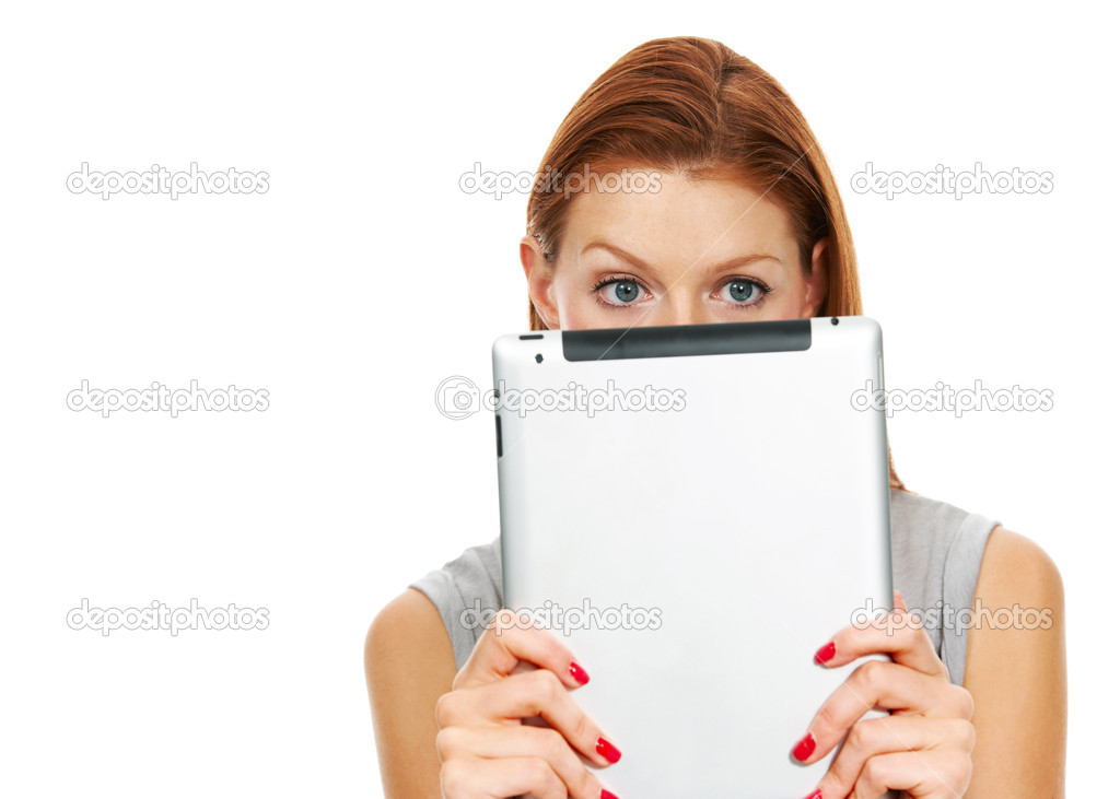 Portrait of a young woman peering over the top of a digital tablet  Stock Photo #12303067