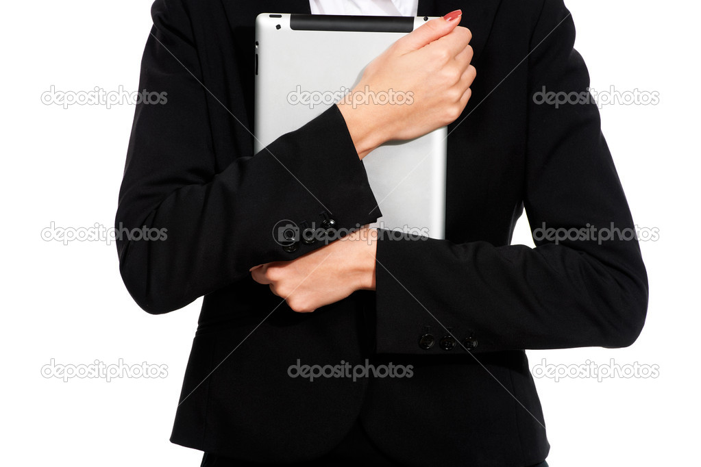 A young businesswoman holding her digital tablet close to her chest — Stock Photo #12303085