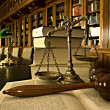 Decorative Scales of Justice in the library - Stock Photo