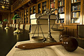 Decorative Scales of Justice in the library — Stock Photo