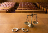 Decorative Scales of Justice and handcuffs — Stok fotoğraf